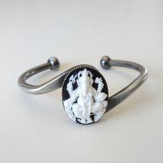 Hey, I found this really awesome Etsy listing at https://www.etsy.com/listing/156261007/ganesh-ganesha-cuff-bracelet-black-and