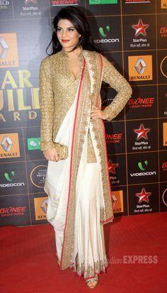 Jacqueline Fernandez went desi in an Anand Kabra sari which she wore wih a long golden blouse at the Star Guild Awards Lehenga Sari, Saree Dress, Lehenga With Long Choli, Saree With Long Blouse, Anarkali, Gold Blouse, Saree Draping Styles, Saree Styles, Drape Sarees