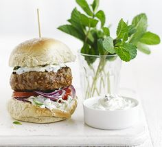 Homemade burgers are always a winner - try this low-calorie, Greek spin with cucumber and mint yogurt and spicy patties