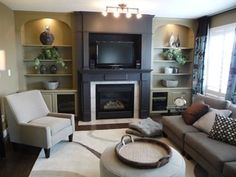 Updated Builder's Special - eclectic - family room - edmonton - by Henry's Purveyor of Fine Things