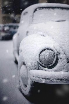 Snow covered Volkswagen Beetle