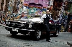 Our 1966 GT convertible Mustang with red interior in Melbourne's Hosier Lane for Joe and Zahra's wedding - photography by Sakhi.