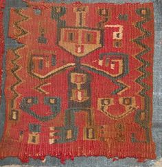 Huari textile fragment; cotton warps and camelid wefts; interlocked tapestry; standing frontal figure with arms held out and hands curling in towa...