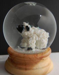 Glass lamb snow globe by Marcy Lamberson