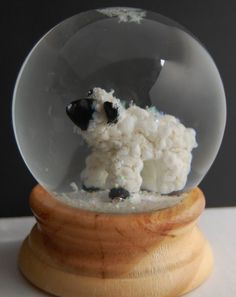 Glass lamb snow globe by Marcy Lamberson