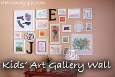 The Money Pit: Crafts - I like the initials beside the children's artwork. Kids' artwork could also be displayed in their bedrooms or playroom.