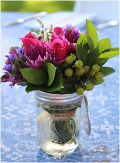 flower arrangement in jam jar -- cute for a rustic outdoor table. thisnapavalleygirl.blogspot.com
