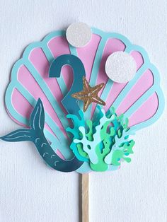 Can be customized to match the colors of your event and age of your child. Size: 10 x 4 inch (measurements includes stick) Mermaid Party Decorations, Mermaid Parties, Birthday Party Decorations, Party Themes, Mermaid Cake Pops, Mermaid Cakes, Mermaid Birthday Cakes, Birthday Cake Toppers, 3rd Birthday