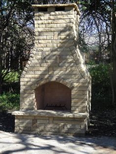 Many outdoor fireplaces look like they're more proportioned for a hotel Backyard Fireplace, Outdoor Fireplaces, Foyer, Outdoor Living, Photo Galleries, Porch, New Homes, Interior Design, Yard Ideas