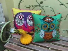 Fun, whimsical pillows add a splash of color on a sofa, side chair or bed.