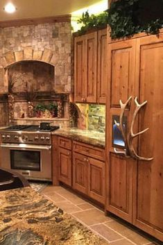 Awesome Kitchen with shed Elk Refrigerator Handles, yes Real Shed Antlers!... by Antler Artisans.