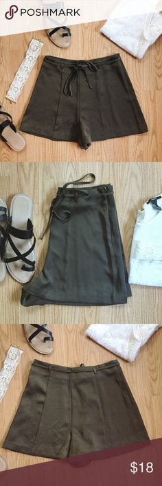 ▪️F21 Self Tied Silky Olive Green Shorts▪️ ▪️Product Description ▪️ ▫️Silky olive green shorts that look classy and chic with lace details and other neutral tones  ▫️Perfect for dressy occasions or the more casual boho inspired looks  ▫️100% Polyester  ▫️String to self tie, zips up, and clasps   ▪️Fit: True to size, fitted high waist (25/26 inch waist suitable), loose and flowing in the hip/thighs, fabric is longer towards the crotch ▪️Condition: NWOT ▪️Measurements: Approx/Laying Flat…