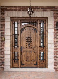 intricate wood door with iron work
