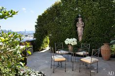 On a terrace, an 18th-century caryatid nestles into a cherry laurel hedge; the furniture is vintage Pier 1 Imports. Pick up a copy of AD's February issue, on newsstands now, or download the digital edition to see more photos and to read the complete story.