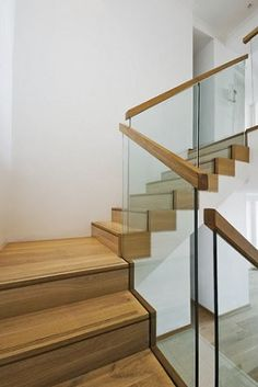 Glass railing with wood handrail. more contemporary option
