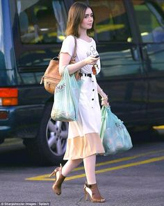 Deeper shade of pale: Collins' white outfit showed off her trim physique and fair skin