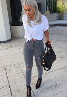 Consider teaming a white crew-neck t-shirt with grey ripped slim jeans for a casual level of dress. Add black cutout suede pumps to your look for an instant style upgrade.   Shop this look on Lookastic: https://lookastic.com/women/looks/white-crew-neck-t-shirt-grey-skinny-jeans-black-pumps/18671   — White Crew-neck T-shirt  — Grey Ripped Skinny Jeans  — Black Leather Tote Bag  — Black Cutout Suede Pumps
