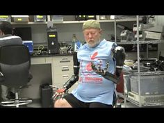 Double amputee controls two prosthetic arms at once, using his mind