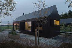 Format Elf Architekten adds blackened timber cottages to a rural German resort | IKEA Decoration