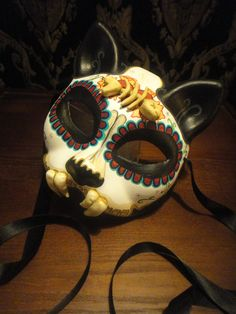 Fishbones Kitty Day of the Dead Cat Mask - Sculpted Bones and Fangs Dia de los Muertos Rose and Heart Tattoo Flash. $75.00, via Etsy.    . . . I have so many ideas . . .