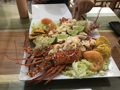 [I Ate] Lobster stuffed with octopus. Fried plantains on the side. Puerto Rico. [4032x3024]