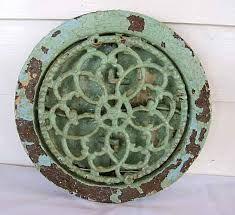 Painted decorative antique round grate.