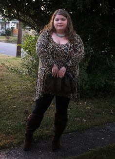 Cute plus size fashion outfit. Leopard tunic, leggings, and furry boots.