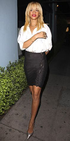 Rihanna - white blouse tucked into a black pencil skirt and finished with metallic accessories