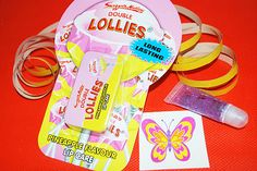 You choose the cellophane bag which can be tied with curling ribbon and optional sweets. We'll fill it with a long lasting pineapple flavoured tin of Double Lollies Lip Care; a Miners Glitzy Kitz mini body glitter and a temporary butterfly tattoo £2.20