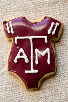 Cookies with just a Jersey (not a onesie)...her baseball one maybe?  GREAT idea! :)