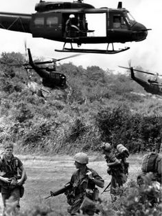 Vietnam war poster. Door gunners looking for trouble as they pull out of troop insertion at the LZ.