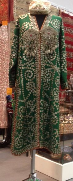 """Chapan — a quilted dressing gown, irreplaceable part of men's and women's clothing. It is unusually popular in the Central Asian region, including Uzbekistan, Tajikistan, Afghanistan, Kyrgyzstan, Kazakhstan and neighboring countries. Chapan - the long and wide dressing gown which doesn't have buttons and a collar. For each season there was the dressing gown, it could be absolutely easy, even without pad, or very warm, on a wadded basis.  Gallery of ""SamArt"""