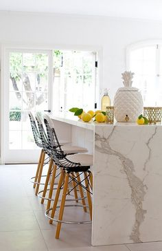 Island Marble Waterfall Countertop - Design photos, ideas and inspiration. Amazing gallery of interior design and decorating ideas of Island Marble Waterfall Countertop in closets, kitchens by elite interior designers. Kitchen Interior, New Kitchen, Kitchen Dining, Kitchen Decor, Kitchen White, Kitchen Stools, Marble Interior, Kitchen Ideas, Island Kitchen