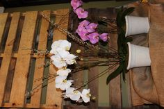 Twigs and Pussy Willows compliment the beauty of the orchids