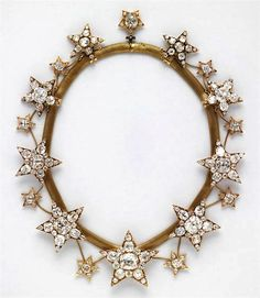 Necklace of the Stars, Portugal Royal Jewels - Necklace of the Stars (Colar das Estrelas) and was commissioned in 1865 by Queen Cosort Maria Pia of Savoy, wife of  King Luís I of Portugal.  It may be hard to tell from this picture, but the heirloom consists of both colorless and pink diamonds.