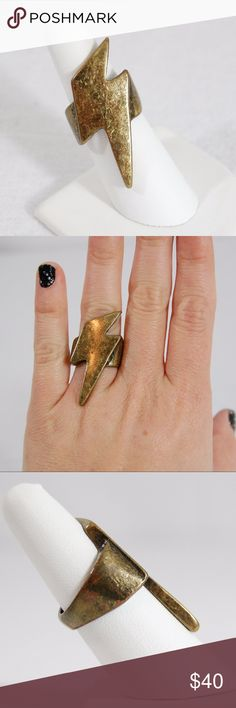 Edgy Lightning Bolt Ring Gold lightning large statement ring. Handmade and stunning.   Excellent condition - the tarnished/beat up look is the design and how it was purchased. Never worn - bought from a custom jewelry designer at an expo.  Approximately Size 7. Jewelry Rings