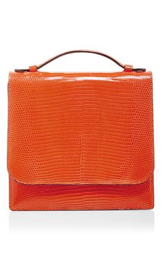 Designer Danielle Corona draws on experience at Valentino for her ultra-luxurious accessories crafted from the finest exotic skins. Finished with handmade Italian hardware, this **Hunting Season** crossbody bag is crafted in orange lizard leather for a strikingly chic accessory.