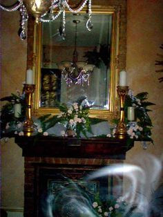 The Real Haunted Mansion ghosts sent to us by Rob Bruce. Ecto Mist, and faces in the mirror. These photo were take right before a wedding in a very haunted house. Strange things happened during the wedding lights flickered the air-conditioner broke and things went missing. Also many , many strange voices were heard on the video tape. Many of the pictures showed strange shapes and glowing orbs.
