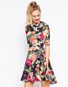 Image 1 of ASOS Skater Dress with Dipped Hem in Floral Print White Skater  Dresses 6466b0e73