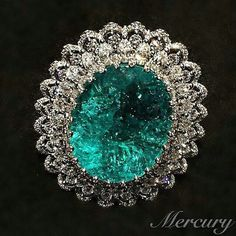 I can't get enough of this cool blue as a swimming pool Chopard ring in white gold from the 2015 Haute Joaillerie collection, featuring a lacework ribbon of diamonds surrounding by a 41.57ct Paraiba tourmaline.