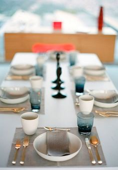 Deep teal glass, gold flatware, sand linens:  Simple and elegant but not boring.  The gold and teal glass complement each other very nicely.
