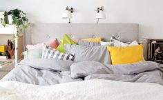 Pile on the pillows! Soft yet bright textiles and lighting can turn a bedroom into a relaxing retreat | See Ulrica's bedroom makeover in the August issue of live magazine