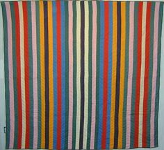 """Reversible Joseph's Coat Quilt; Ca. 1890; Pa.  This is a completely reversible Mennonite Joseph's Coat pattern from Lancaster, Pennsylvania. On one side, the bars are 2 1/4"""" in width; on the reverse, they are 5 1'2"""". Pristine condition; chevron pattern quilting. Circa 1890; measures 85"""" x 90""""."""