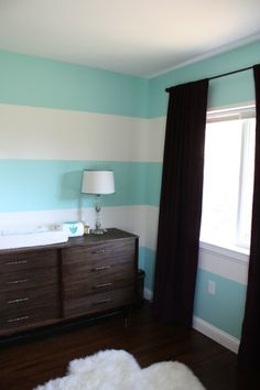 Aqua & White Stripe Accent Wall (with dark furniture)