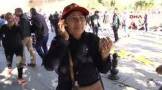 Woman talks on phone after blast in Ankara