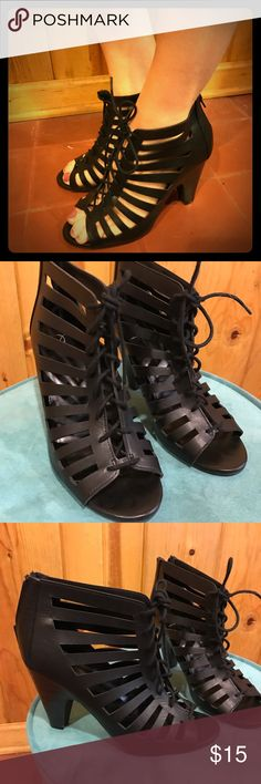 Black size 9 lace-up front heels Perfect simple heel to pair with almost any dress or even with jeans for a more casual look! Size 9, lace-up bootie style heels in black leather finish, cute exposed slits on the sides. New condition, never worn out of the house as they're too small for me! Shoes Heels