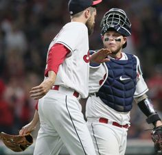 Cleveland Indians Andrew Miller and catcher Roberto Perez after Miller pitched into and out of a bases loaded jam in the 7th inning against the Houston Astros at Progressive Field,  on April 26, 2017.     (Chuck Crow/The Plain Dealer). Indians won 7-6