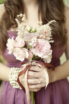 small bridesmaid bouquets JUST like this but with only ivory and white. wrapped in tulle.