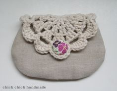 This is a linen pouch/card case/digital camera case with doily flap.  The flap closes with a fabric covered button that is the same fabric with the pouch lining.