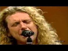 Robert Plant of Led Zeppelin, Whole Lotta Love,  Italy Unplugged RP playing guitar-a rare find. I rarely see him playing an instrument on stage.